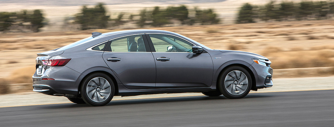 A silver 2019 Honda Insight Hybrid driving down an open road