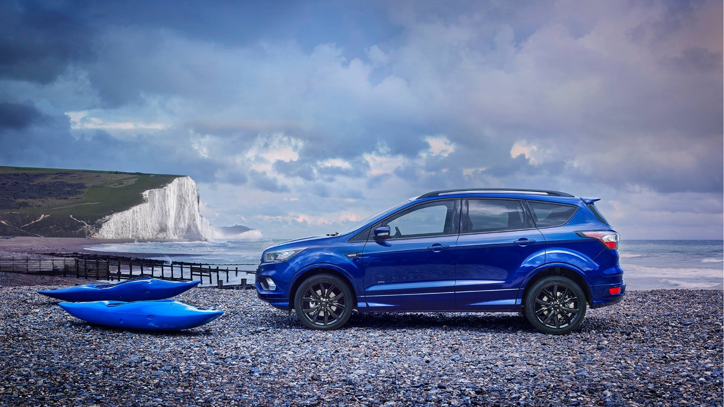 ford-kuga-uk-16x9-2160x1215-ol-blue-ford-kuga-parked-by-the-sea.originalRendition.jpg