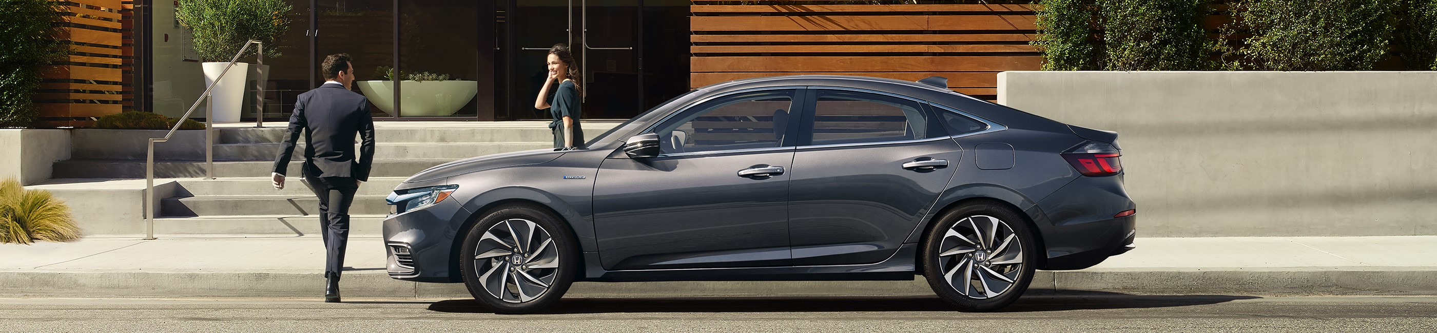 A couple getting out of the 2019 Honda Insight