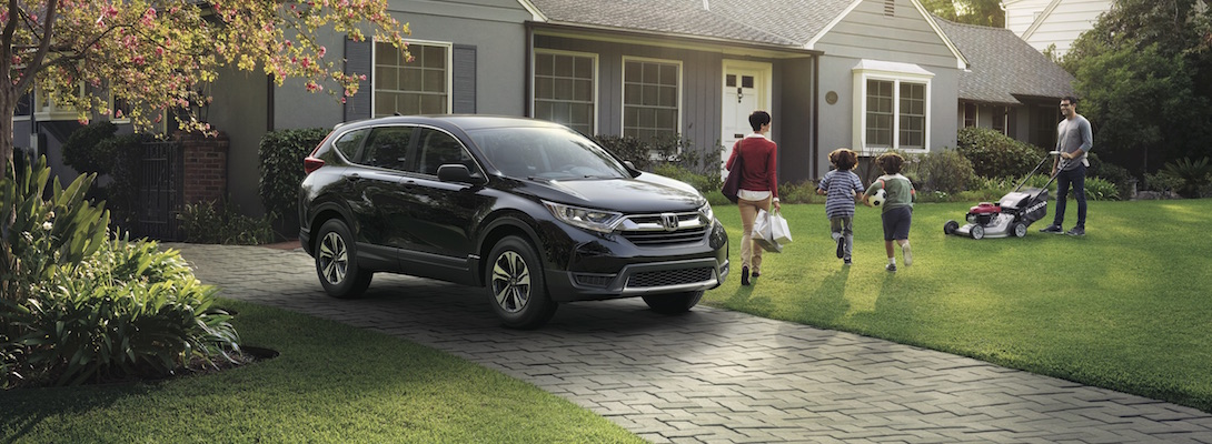 A family coming home in their Honda CR-V