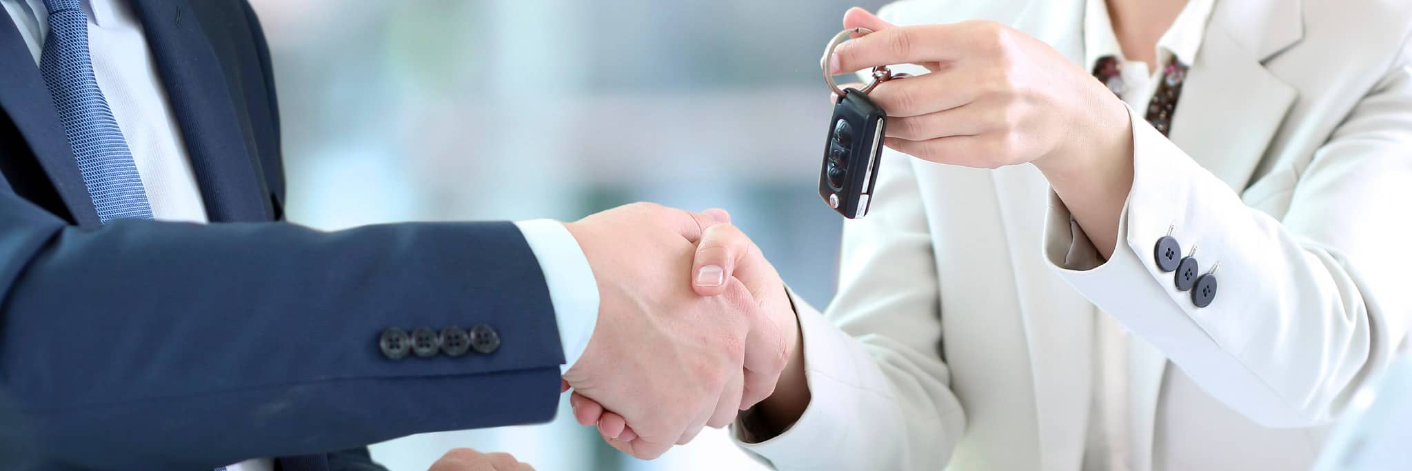 Car saleswoman handing over keys | Victoria, TX