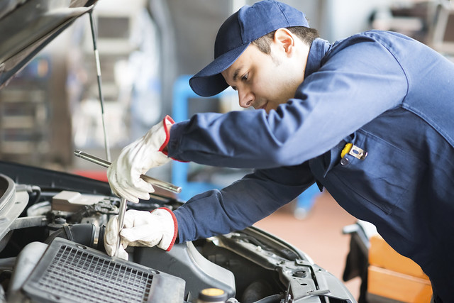 service technician working under the hood