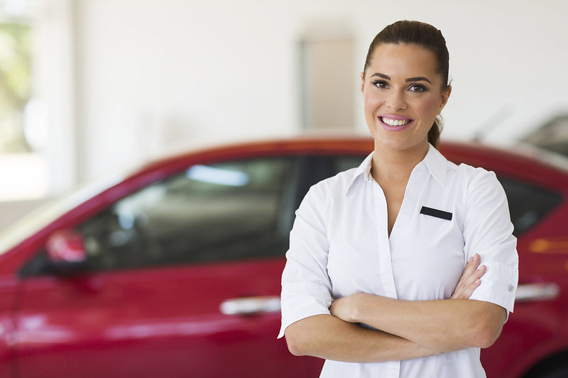 Picture of a female at a car dealership.