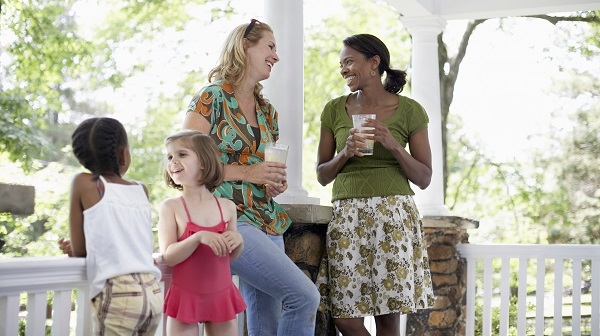Young moms talking on a porch