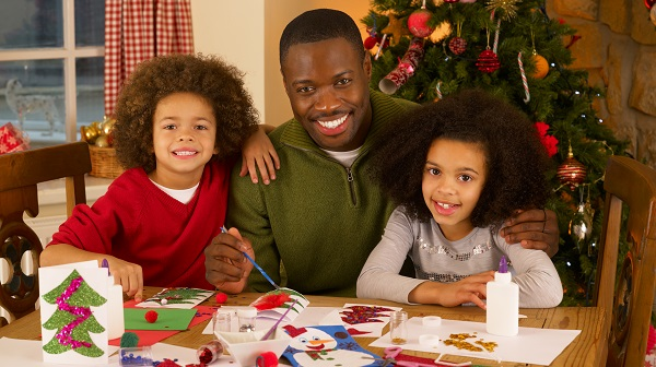 Father Helping Kids Make Cards