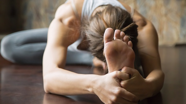 Woman stretching on the floor