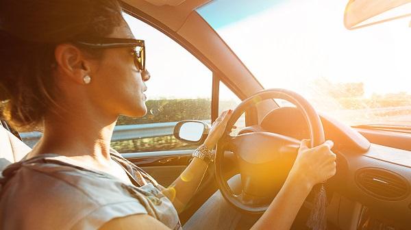 woman driving at sunset
