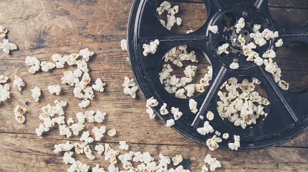 film reel on a counter with spilled popcorn