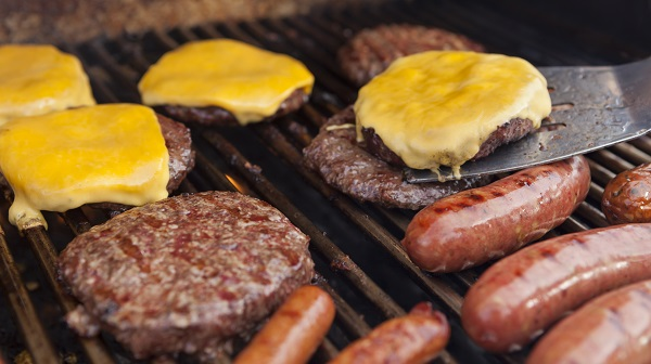 burgers and sausages on a grill