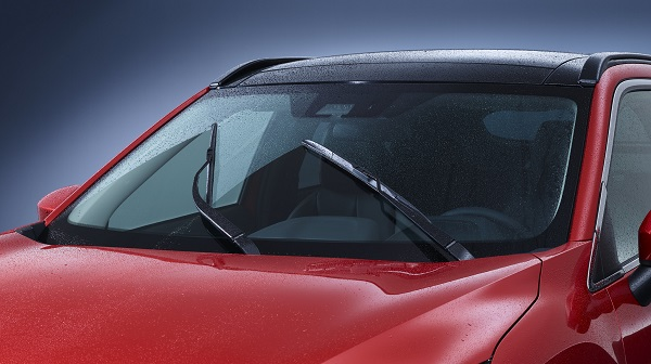 wet car with windshield wipers on