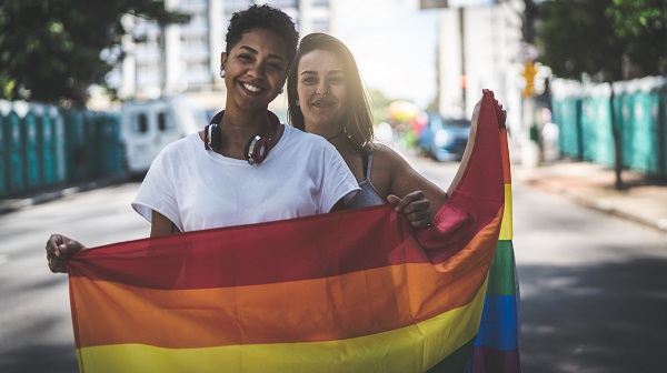lgbtq couple with pride flag