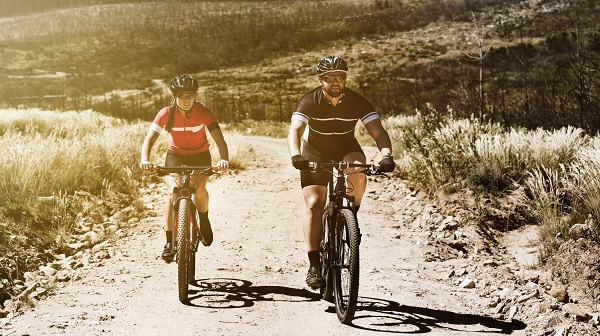 Two people bicycling on a trail